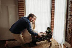 newborn in antique cradle family studio powder springs, ga