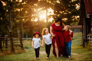 family walking and smiling together at farm in marietta ga